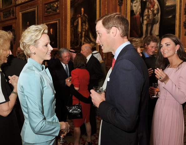Prince William, Duke of Cambridge speaks to Princess Charlene of Monaco during a reception in the Waterloo Chamber, before the Lunch For Sovereign Monarchs at Windsor Castle, on May 18, 2012 in Windsor, England.