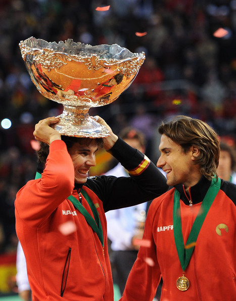 Rafael Nadal Rafael Nadal (L) of Spain holds the Davis Cup trophy as he celebrates with his teammate David Ferrer during the third and last day of the final Davis Cup match between Spain and Argentina on December 4, 2011 in Seville, Spain.