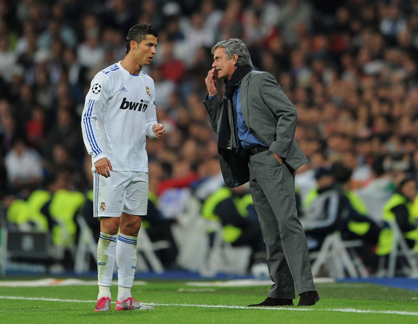Head Coach Jose Mourinho (R) of Real Madrid instructs Cristiano Ronaldo during the UEFA Champions League group G match between Real Madrid and AC Milan at the Estadio Santiago Bernabeu on October 19, 2010 in Madrid, Spain.