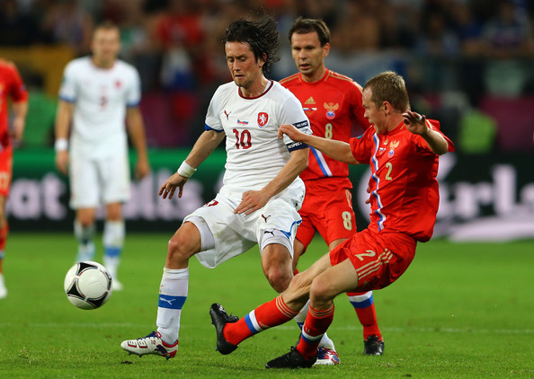 Tomas Rosicky Tomas Rosicky of Czech Republic and Aleksandr Anyukov of Russia compete for the ball during the UEFA EURO 2012 group A match between Russia and Czech Republic at The Municipal Stadium on June 8, 2012 in Wroclaw, Poland.