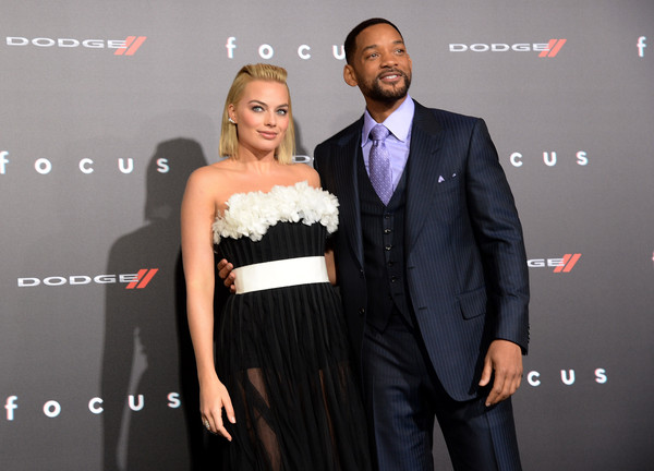"""Will Smith Actors Will Smith (R) and Margot Robbie attend the Los Angeles Premiere of """"Focus"""" Sponsored By Dodge at TCL Chinese Theatre on February 24, 2015 in Hollywood, California."""
