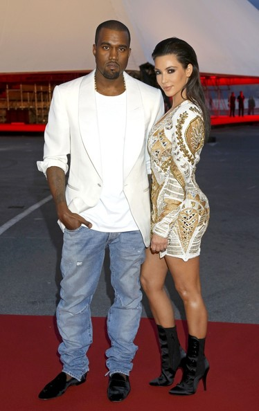 """Kanye West and Kim Kardasian arriving at premiere of short art film """"Cruel Summer"""", as part of Cannes Film Festival, in Cannes, France, Kanye West prefers Kim Kardashian to have a """"natural"""" look like Catherine Middleton.The rapper has been advising his reality TV star girlfriend's style team on how he wants her to look, naming Catherine, the Duchess of Cambridge, as a reference point."""