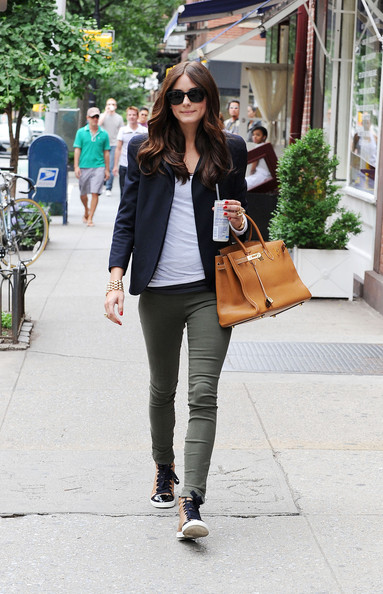 "Olivia Palermo .Olivia Palermo shows off her new sneakers and Birkin bag while heading to the set of ""The City"" in NYC. The petite reality star, wearing army green pocketless pants, is seen sipping onto her Redbull energy drink with a straw."