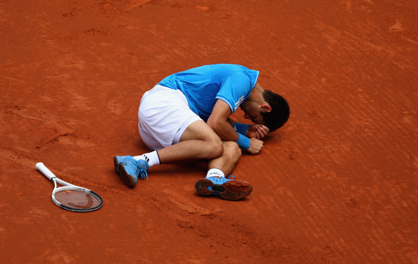 Novak Djokovic Novak Djokovic of Serbia lies on the court after slipping on the clay against Oscar Hernandez of Spain in their second round  match during the Madrid Open tennis tournament at the Caja Magica on May 13, 2009 in Madrid, Spain.  (Photo by Clive Brunskill/Getty Images) *** Local Caption *** Novak Djokovic