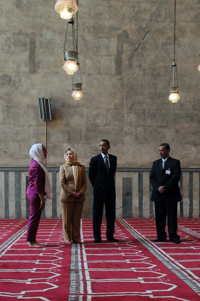 "US President Barack Obama (2nd R) and his Secretary of State Hillary Clinton (2nd L) visit the Sultan Hassan mosque before making his key Middle East policy speech on June 4, 2009 in Cairo, Egypt.  Obama called for a ""new beginning between the United States and Muslims"", declaring that ""this cycle of suspicion and discord must end"".  (Photo by Sameh Refaat - Pool/MENA/Getty Images) *** Local Caption *** Barack Obama;Hillary Clinton"