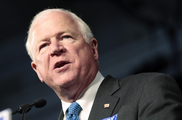 U.S. Sen. Saxby Chambliss (R-GA) talks with supporters as he campaigns on December 1, 2008 in Perry, Georgia. Chambliss is up against Democrat Jim Martin in a runoff election for the U.S. Senate seat tomorrow.