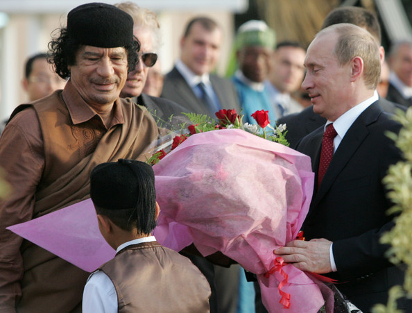 Libyan leader Muammar Qadaffi greets President Vladimir Putin of Russia on April 16, 2008 In Tripoli, Libya. Putin is in Libya for a two-day official visit to rebuild Russian-Libyan relations.