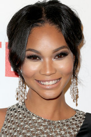 Chanel Iman Accessorized With A Pair Of Diamond Chandelier Earrings That Echoed The Embellishments On Her