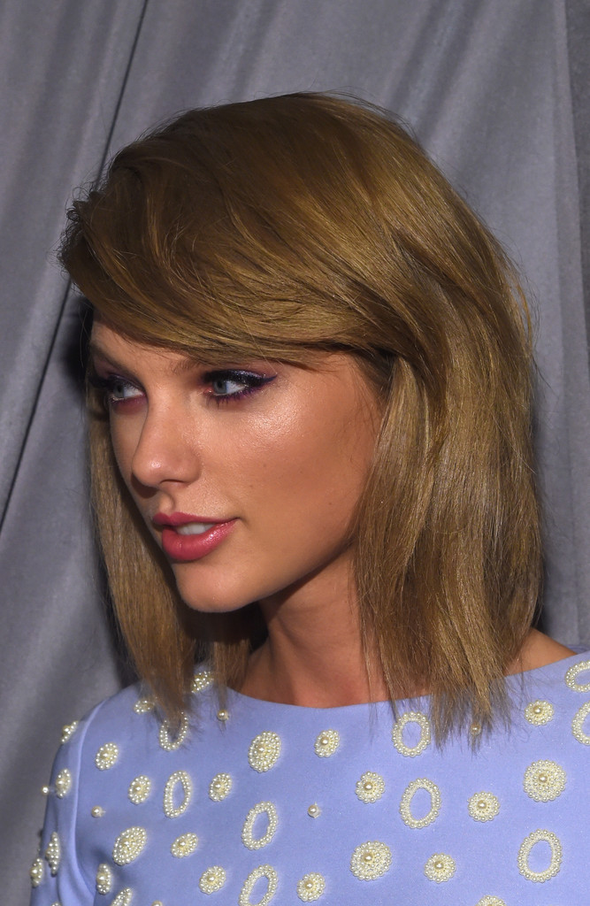 Taylor Swift Medium Straight Cut with Bangs  Taylor Swift Looks  StyleBistro