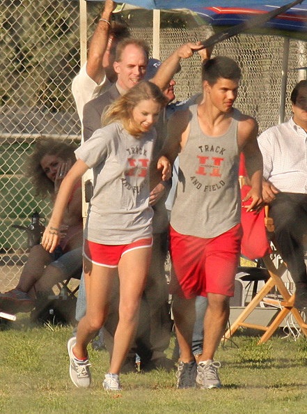 Taylor Swift Teen star Taylor Lautner does a running flip after a kissing
