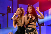 Recording artists Ariana Grande (L) and Nicki Minaj perform onstage during the 2014 iHeartRadio Music Festival at the MGM Grand Garden Arena on September 19, 2014 in Las Vegas, Nevada.
