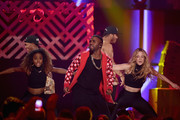 Singer Jason Derulo (center) performs onstage during the 2014 iHeartRadio Music Festival at the MGM Grand Garden Arena on September 19, 2014 in Las Vegas, Nevada.