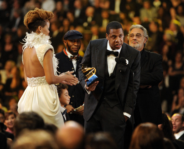 Rihanna (L) and Jay-Z (2nd Right) accept the Best Rap/Sung Collaboration from Mos Def (2nd L) and Placido Domingo (R) onstage during the 52nd Annual GRAMMY Awards held at Staples Center on January 31, 2010 in Los Angeles, California.