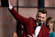 Singer Sam Smith (L) accepts the Best New Artist award from singer Taylor Swfit onstage during The 57th Annual GRAMMY Awards at the at the STAPLES Center on February 8, 2015 in Los Angeles, California.