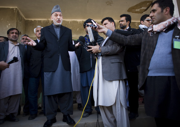 Afghan President Hamid Karzai talks to media after meeting with local elders March 7, 2010 in the southern province of Helmand of Marjah, Afghanistan. Afghan President Hamid Karzai heard a litany of complaints Sunday from residents of Marjah, the town in the south that thousands of U.S., NATO and Afghan troops just seized from the Taliban. Karzai promised better security for the former Taliban stronghold after complaints of corruption, looting and arrests were reported.