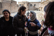 In this handout image provided by UNHCR, UNHCR Special Envoy Angelina Jolie meets meets displaced Iraqis who are members of the minority Christian community, living in an abandoned school, on January 26, 2015 in Al Qosh, Iraq. Ms Jolie was on the second day of her visit to Iraq. She is visiting Syrian refugees and displaced Iraqi citizens in the Kurdistan Region of Iraq to offer support to 3.3 million displaced people in the country and highlight their dire needs.