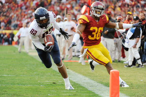 Juron Criner Corner back Josh Pinkard #36 of the USC Trojans reacts as wide receiver Juron Criner #82 of the Arizona Wildcats stumbles into the end zone with a 36-yard touchdown pass late in the foruth quarter of the NCAA college football game at the Los Angeles Coliseum on December 5, 2009 in Los Angeles, California. Arizona won 21-17.