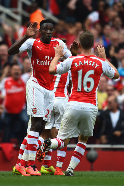 Danny Welbeck and Aaron Ramsey of Arsenal celebrate after Jack Wilshere of Arsenal (not pictured) scores their first goal during the Barclays Premier League match between Arsenal and Manchester City at Emirates Stadium on September 13, 2014 in London, England.