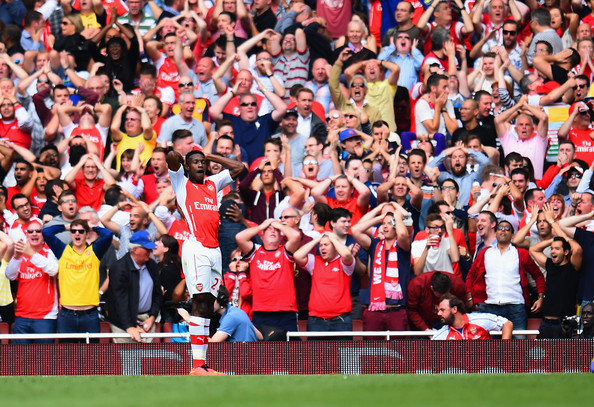 Danny Welbeck of Arsenal reacts after a missed chance during the Barclays Premier League match between Arsenal and Manchester City at Emirates Stadium on September 13, 2014 in London, England.