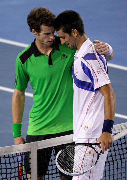 Andy Murray of Great Britain (L) congratulates Novak Djokovic of Serbia after winning championship point in their men's final match during day fourteen of the 2011 Australian Open at Melbourne Park on January 30, 2011 in Melbourne, Australia.