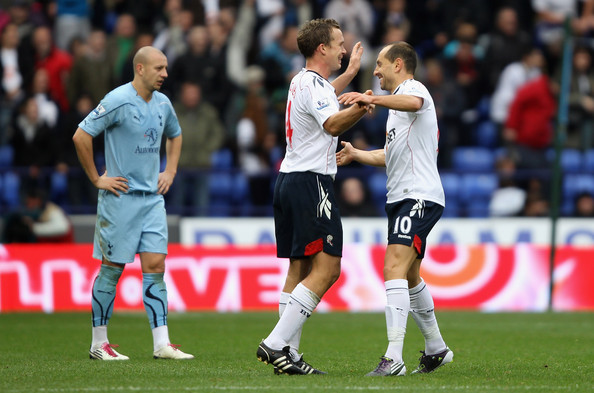 Martin Petrov of Bolton Wanderers celebrates with team mate Kevin Davies after scoring the fourth goal past Tottenham Hotspur keeper Heurelho Gomes during the Barclays Premier League match between Bolton Wanderers and Tottenham Hotspur at the Reebok Stadium on November 6, 2010 in Bolton, England.