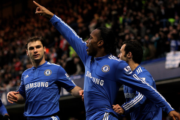 Didier Drogba of Chelsea celebrates scoring the first goal of the game with team mates during the Barclays Premier League match between Chelsea and Arsenal at Stamford Bridge on February 7, 2010 in London, England.