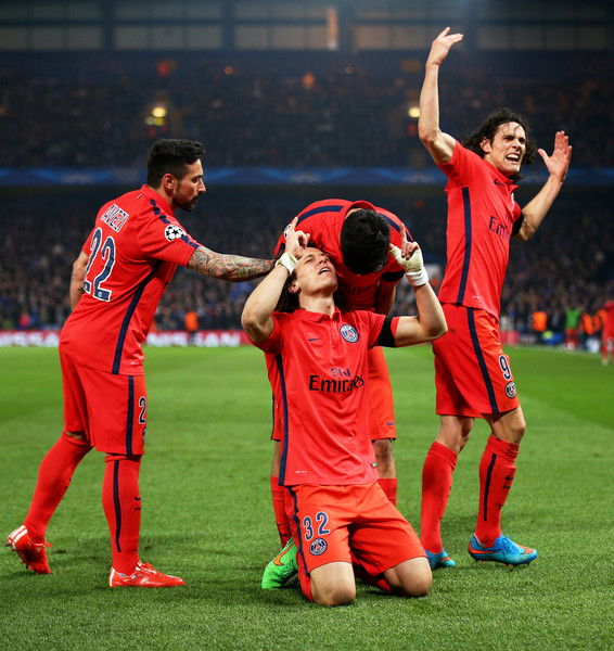 David Luiz (C) of PSG celebrates after scoring a goal to level the scores at 1-1 during the UEFA Champions League Round of 16, second leg match between Chelsea and Paris Saint-Germain at Stamford Bridge on March 11, 2015 in London, England.