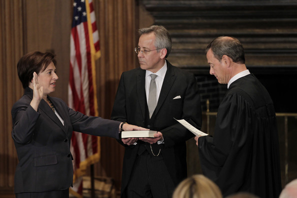 Elena Kagan (L) is sworn in as the Supreme Court's newest member as Chief Justice John Roberts (R) administers the judicial oath, as Jeffrey Minear (C) counselor to the chief justice, holds the Bible at the Supreme Court Building August 7, 2010 in Washington, DC.