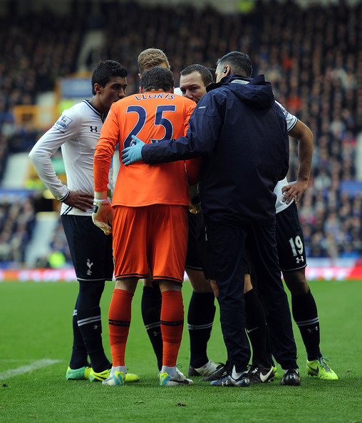 Hugo Lloris of Tottenham Hotspur speaks to referee Kevin Friend during the Barclays Premier League match between Everton and Tottenham Hotspur at Goodison Park on November 03, 2013 in Liverpool, England.