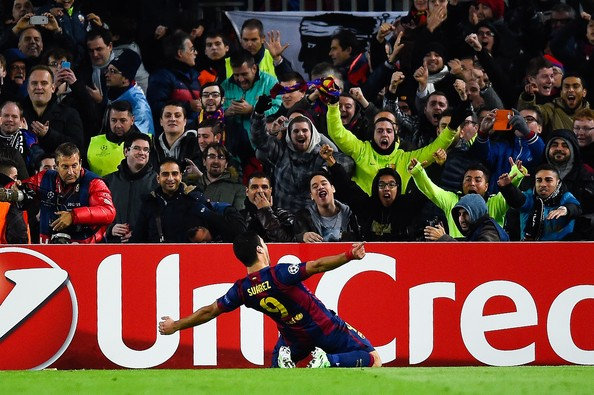 Luis Suarez of FC Barcelona celebrates after scoring his team's third goal during the UEFA Champions League group F match between FC Barcelona and Paris Saint-Germanin FC at Camp Nou Stadium on December 10, 2014 in Barcelona, Spain.
