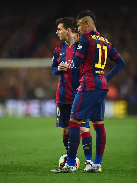 Lionel Messi and Neymar of Barcelona line up a free kick during the La Liga match between FC Barcelona and Real Madrid CF at Camp Nou on March 22, 2015 in Barcelona, Spain.