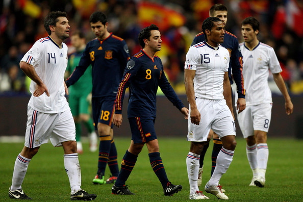 Jeremy Toulalan #14, Florent Malouda #15 and Yoann Gourcuff #8 of France walk off dejectedly at the final whistle of the France v Spain International Friendly match at the Stade de France on March 3, 2010 in Paris, France.