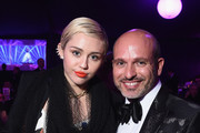 Singer/songwriter Miley Cyrus (L) and Alessandro Maria Ferreri attend the 23rd Annual Elton John AIDS Foundation Academy Awards Viewing Party on February 22, 2015 in Los Angeles, California.