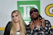 Meghan Trainor (L) and Lil Jon attend KISS 108's Jingle Ball 2014, presented by Market Basket Supermarkets at TD Garden on December 14, 2014 in Boston, Massachusetts.