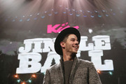Nick Jonas speaks onstage during KISS 108's Jingle Ball 2014, presented by Market Basket Supermarkets at TD Garden on December 14, 2014 in Boston, Massachusetts.