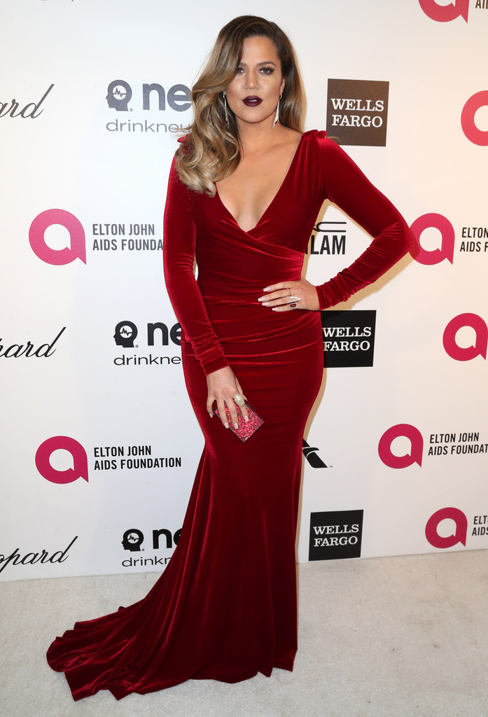 Khloe Kardashian looked sultry in a red burgundy velvet dress