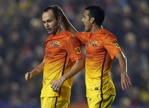 Andres Iniesta (L) of Barcelona celebrates scoring with his teammate Pedro Rodriguez during the la Liga match between Levante UD and FC Barcelona at Ciutat de Valencia on November 25, 2012 in Valencia, Spain.