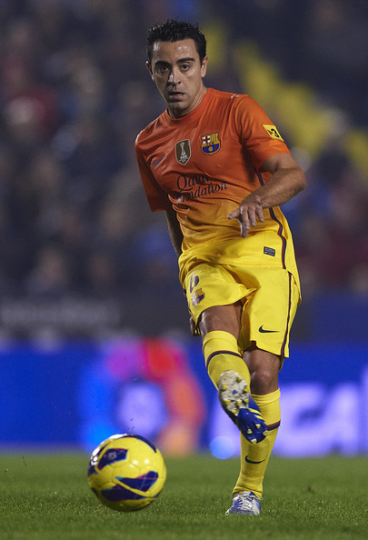 Xavi Hernandez of Barcelona in action during the La Liga match between Levante UD and FC Barcelona at Ciutat de Valencia on November 25, 2012 in Valencia, Spain.