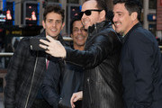 (L - R) Joey McIntyre, Danny Wood, Donnie Wahlberg and Jonathan Knight of New Kids On The Block pose for a selfie during a press conference at Madison Square Garden on January 20, 2015 in New York City.