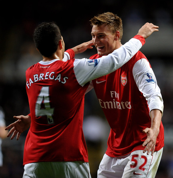 Nicklas Bendtner of Arsenal celebrates scoring his team's third goal with team mate Cesc Fabregas during the Carling Cup Fourth Round match between Newcastle United and Arsenal at St James' Park on October 27, 2010 in Newcastle, England.