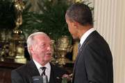 U.S. President Barack Obama (R) presents John Keaveney (L) with a 2011 Presidential Citizens Medal during a ceremony at the East Room of the White House October 20, 2011 in Washington, DC. The medal was established for the purpose of recognizing U.S. citizens who have performed exemplary deeds of service for their country and fellow citizens.