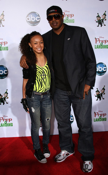 """Cymphonique Miller Actress Cymphonique Miller (L) and her father Master P attend the """"Prep & Landing"""" film premiere at The El Capitan Theatre on November 16, 2009 in Hollywood, California."""
