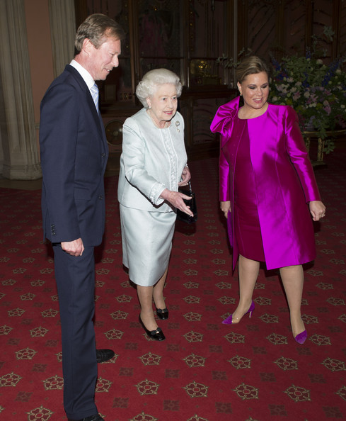Queen Elizabeth II greets The Grand Duke Henri of Luxembourg and The Grand Duchess Maria Teresa of Luxembourg as they arrive at a lunch for Sovereign Monarch's held in honour of Queen Elizabeth II's Diamond Jubilee, at Windsor Castle, on May 18, 2012 in Windsor, England.