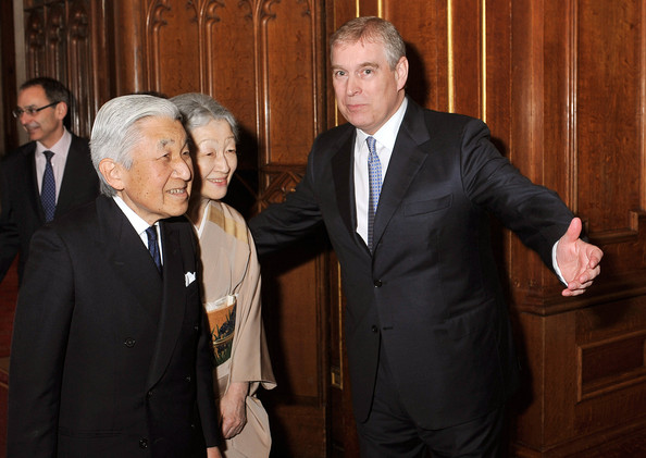Prince Andrew, Duke of York, shows the way for the Emperor Akihito of Japan and Empress Michiko of Japan during a reception in the Waterloo Chamber, before her Sovereign Monarch's Jubilee lunch, at Windsor Castle, on May 18, 2012 in Windsor, England.