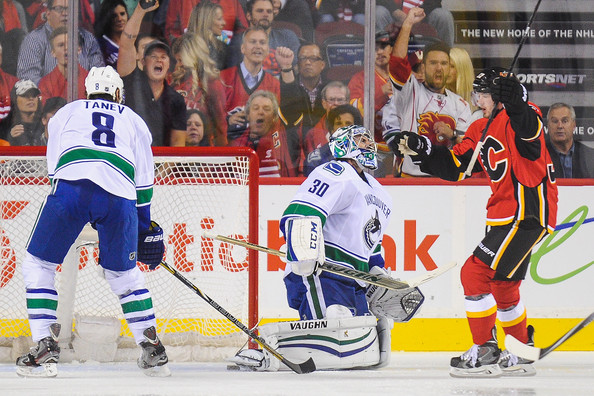 Ryan Miller and Paul Byron - Vancouver Canucks v Calgary Flames