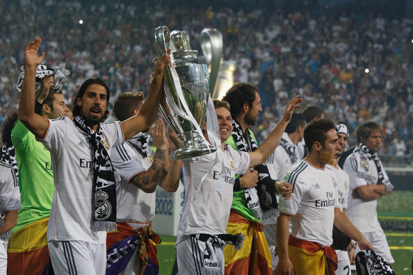 Real Madrid player Sami Khedira (L) lifts the trophy during the Real Madrid celebration the day after winning the UEFA Champions League final at Santiago Bernabeu Stadium on May 25, 2014 in Madrid, Spain. Real Madrid CF achieves their tenth European Cup at Lisbon at Lisbon 12 years later.