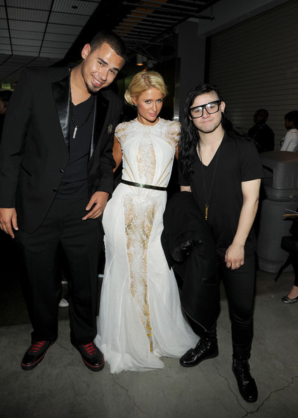 Skrillex Recording Artists Afrojack and Skrillex and Paris Hilton (C) pose backstage at the 54th Annual GRAMMY Awards held at Staples Center on February 12, 2012 in Los Angeles, California.