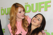 "Actresses Bella Thorne (L) and Mae Whitman attend a special Los Angeles fan screening of ""THE DUFF"" on February 12, 2015 in Los Angeles, California."