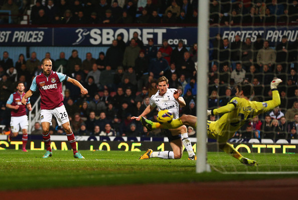 Joe Cole of West Ham United scores his goal during the Barclays Premier League match between West Ham United and Tottenham Hotspur at the Boleyn Ground on February 25, 2013 in London, England.