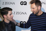 (L-R) Singer/Songwriter Nick Jonas and actor Joel McHale arrive at Z Zegna & GQ Celebrate The New Z Zegna Collection Hosted By Nick Jonas at Philymack Studios on February 5, 2015 in West Hollywood, California.